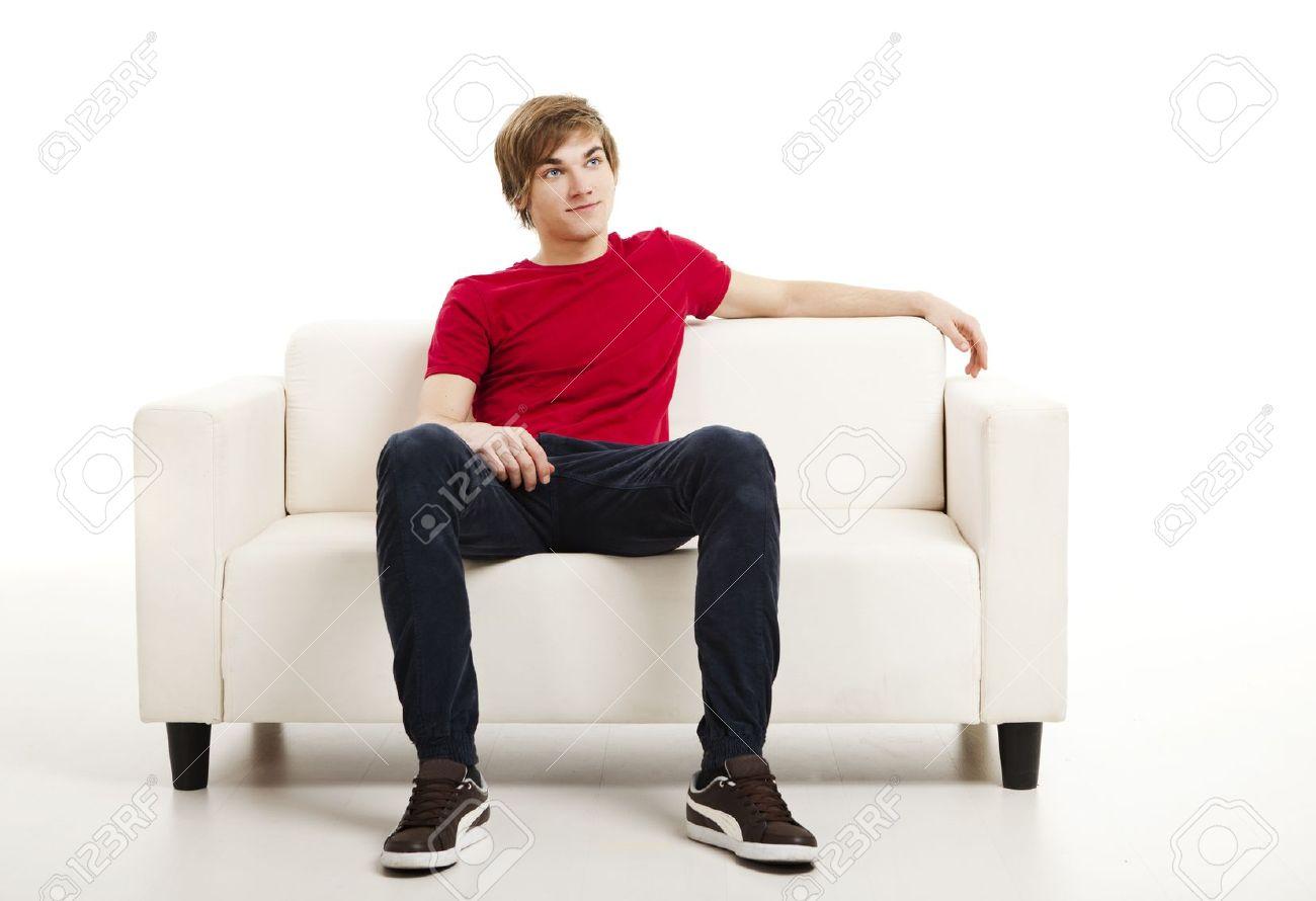 sofa man portrait of young man sitting on office sofa. Black Bedroom Furniture Sets. Home Design Ideas